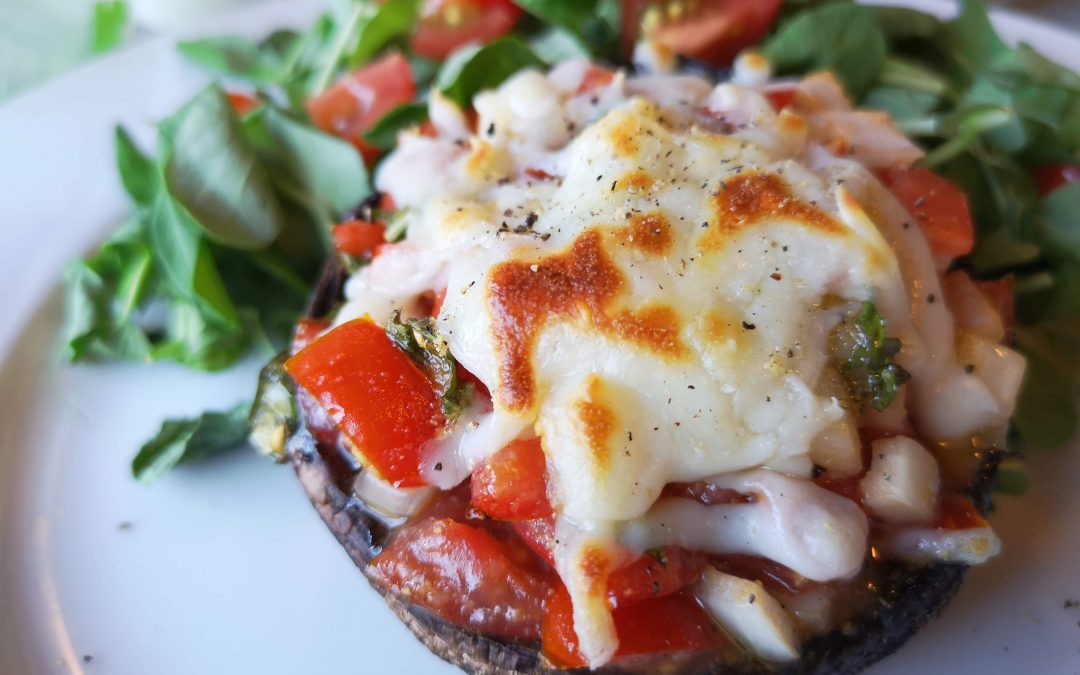 Bruschetta Stuffed Portobello Mushrooms with Fresh Salad Greens