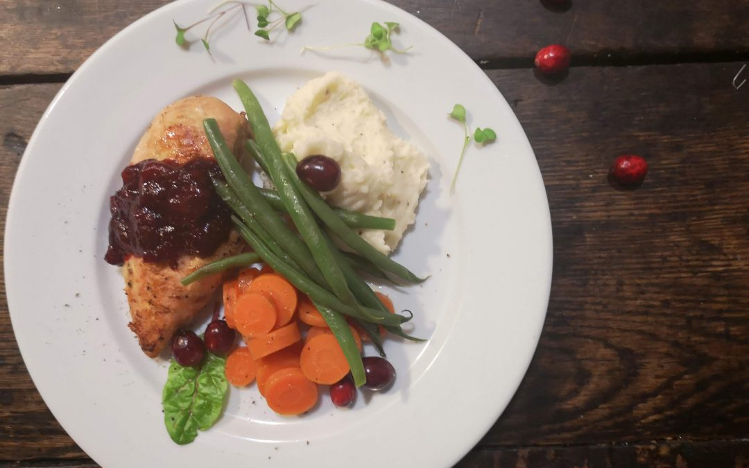 Roasted Chicken with Orange Brandy Cranberry Sauce, Mashed Potatoes, and Buttered Vegetables